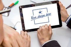 Tablet with hands of business people stock photo