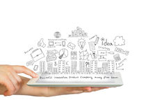 Tablet in hands and business sketches Royalty Free Stock Image