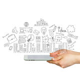 Tablet in hands and business sketches Royalty Free Stock Photography