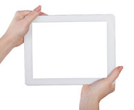 Tablet in  hands on an isolated Stock Photos