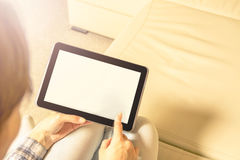 The tablet in hands. Light background. stock photography