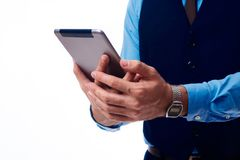 Tablet in the hands of a man royalty free stock photography