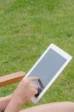 Tablet in hands outside Royalty Free Stock Photos