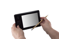 Tablet in the hands of a pensioner with a pencil Stock Photo