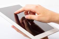 Tablet and Hands on White Background Royalty Free Stock Photos