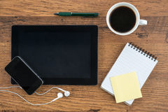 Tablet, headphone, notebook and smart phone with coffee Stock Photos