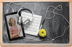 Tablet  and headphones. Stock Photo