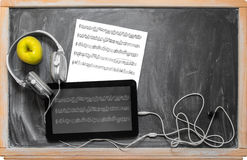 Tablet  and headphones. Royalty Free Stock Photo