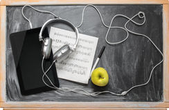 Tablet  and headphones. Royalty Free Stock Images