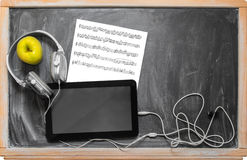 Tablet  and headphones. Stock Photos