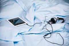 Tablet with headphones Royalty Free Stock Images