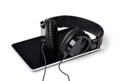Tablet with headphones Stock Images