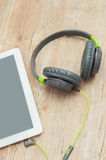 Tablet and headphones Royalty Free Stock Photography