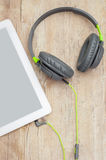 Tablet and headphones Stock Photos