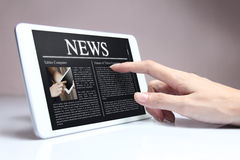 Tablet with hot news on screen. Stock Photo