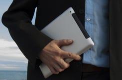 Tablet i hand Arkivbild