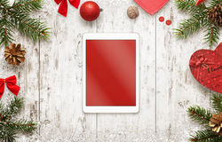 Tablet with isolated screen for mockup with christmas decorations on table stock photography