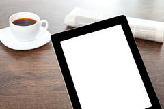 Tablet with isolated screen on a table at a businessman Royalty Free Stock Images