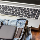 Tablet and jeans Royalty Free Stock Images