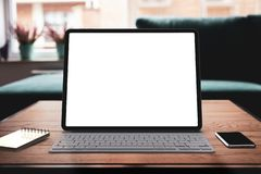 Tablet with keyboard and blank screen royalty free stock image