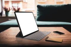 Tablet with keyboard and blank screen stock photo