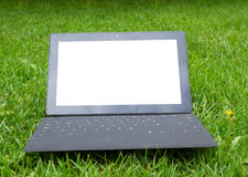 Tablet with keyboard on fresh grass Stock Photo