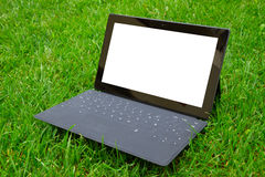 Tablet with keyboard on fresh grass Stock Images