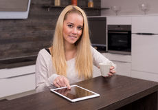 Tablet in the kitchen Stock Photography