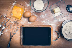 Tablet in the kitchen Royalty Free Stock Images
