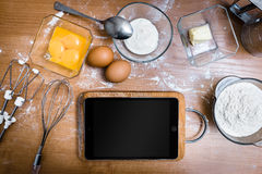 Tablet in the kitchen Royalty Free Stock Photo