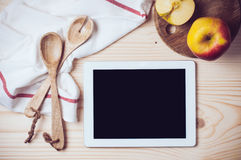 Tablet on kitchen table Stock Photography