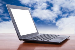 Tablet Laptop with Cloudy Background Stock Photography