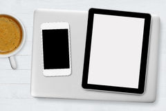 Tablet, laptop, mobile phone. And coffee on wood desk Stock Photos