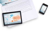 Tablet on laptop and mobile phone near, top view Royalty Free Stock Images