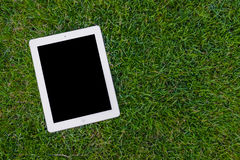 Tablet on lawn Stock Images