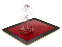 Tablet - liquid splash Stock Photos