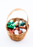Tablet of medicine in small wicker basket Stock Photography