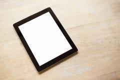 Tablet met het lege witte scherm op houten lijst Royalty-vrije Stock Foto