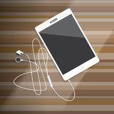 Tablet met Oortelefoon op houten Desktop Stock Afbeeldingen