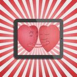 Tablet met rood romantisch hart twee Stock Afbeeldingen