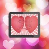 Tablet met rood romantisch hart twee Stock Foto