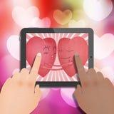 Tablet met rood romantisch hart twee Royalty-vrije Stock Foto