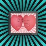 Tablet met rood romantisch hart twee Stock Fotografie