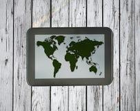 Tablet met wereldkaart Royalty-vrije Stock Afbeeldingen