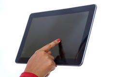 Tablet mit dem Handzeigen Stockfoto