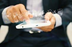 Tablet mit Geschäfts-Ikonen-Idee Stockbilder