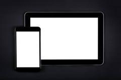 Tablet mit leerem Bildschirm auf schwarzer Tabelle Lizenzfreies Stockbild