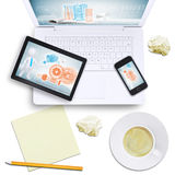 Tablet and mobile on laptop with crumpled paper Stock Photos