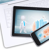 Tablet, mobile on laptop with engineering drawings Stock Photo