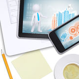Tablet and mobile on laptop with note paper Stock Photography